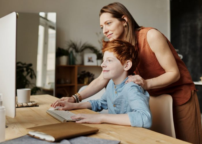 Canva - Photo of Woman Teaching His Son While Smiling